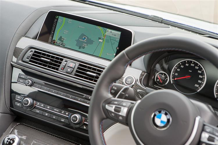 http://f2.caranddriving.com/images/new/big/bmw6seriescoupe0315int.jpg