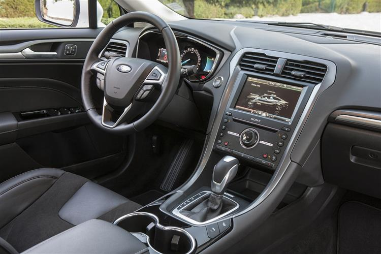 http://f2.caranddriving.com/images/new/big/fordmondeohybrid1214int.jpg